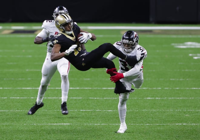 New Orleans Saints wide receiver Michael Thomas (13) catches a pass over Atlanta Falcons free safety Ricardo Allen (37) during the second half at the Mercedes-Benz Superdome.