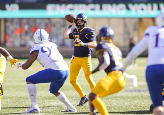 West Virginia quarterback Jarret Doege threw for more than 300 yards against a lackluster Kansas defense on Saturday.