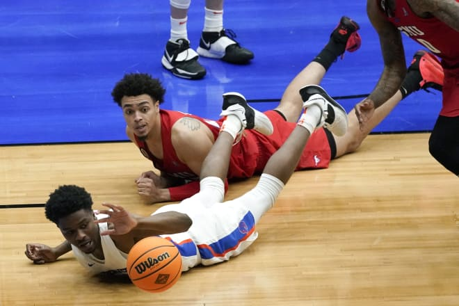 Boise State guard Devonaire Doutrive loses control of the ball ahead of SMU forward Isiah Jasey, rear, during the second half of an NCAA college basketball game in the first round of the NIT, Thursday, March 18, 2021, in Frisco, Texas. Boise State won 85-84.