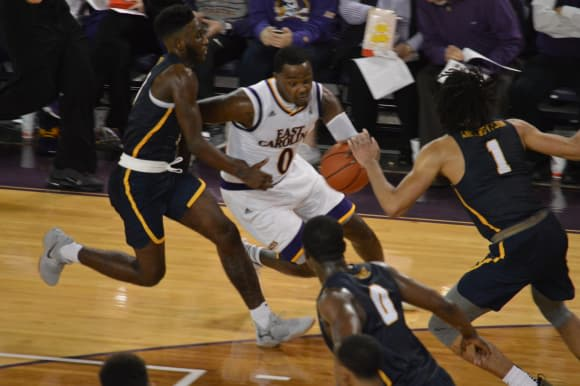 Issac Fleming drives for two of his 14 points in ECU's 75-50 opening night win over Coppin State.