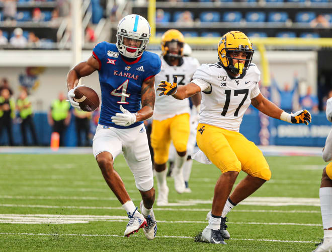 Against the West Virginia football team in 2019, Kansas wide receiver Andrew Parchment (4) totaled 132 yards and two touchdowns.