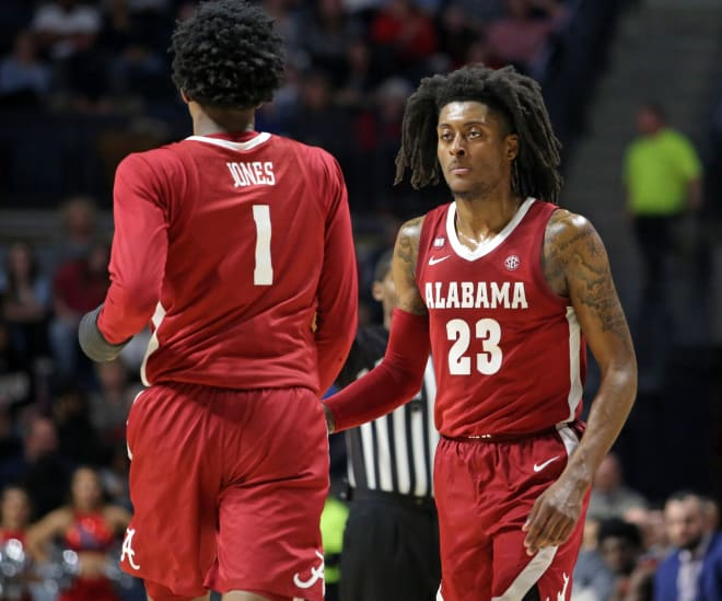 Alabama Crimson Tide guard John Petty Jr. (23) and Alabama Crimson Tide forward/guard Herbert Jones (1) celebrate during the second half against the Mississippi Rebels at The Pavilion at Ole Miss. Photo | Imagn
