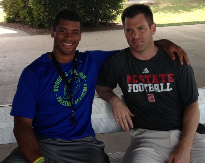 Former NC State Wolfpack football quarterback Russell Wilson with Chad Jamison.