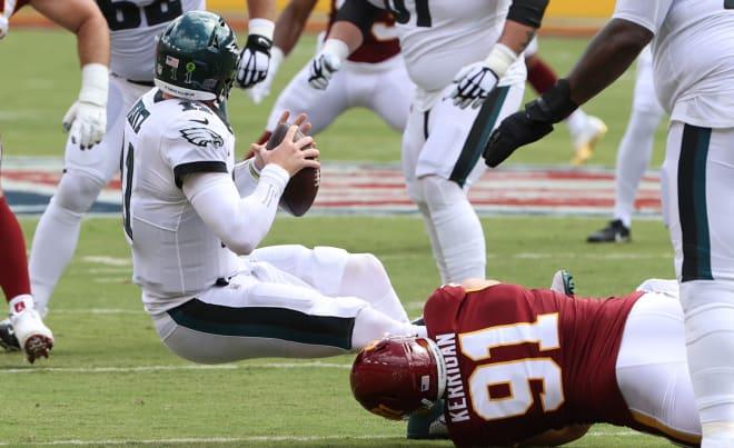 Washington Football Team defensive end Ryan Kerrigan (91) sacks Philadelphia Eagles quarterback Carson Wentz (not pictured) in the second quarter at FedExField.