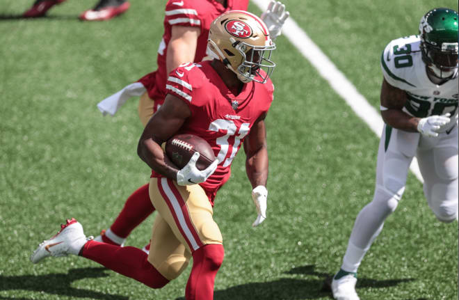 San Francisco 49ers running back Raheem Mostert (31) rushes for a touchdown during the first quarter against the New York Jetsat MetLife Stadium.