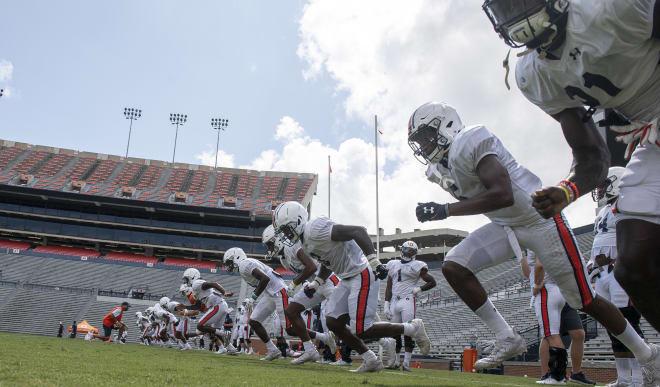 Auburn's defense runs after the team's scrimmage last Saturday.