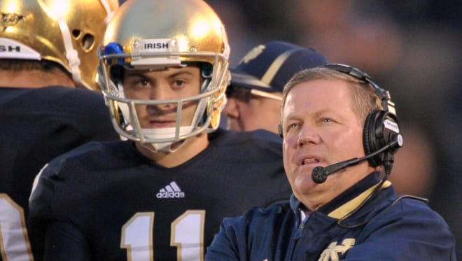 Notre Dame Fighting Irish football head coach Brian Kelly with Tommy Rees during his playing days