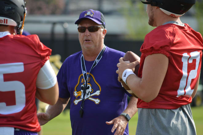 ECU offensive coordinator Donnie Kirkpatrick works with his quarterbacks in Friday's first full practice.