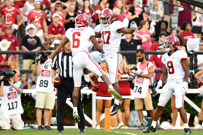 Alabama Crimson Tide receivers DeVonta Smith (6), Jaylen Waddle (17), and John Metchie III (8) celebrate in the end zone. Photo | Getty Images