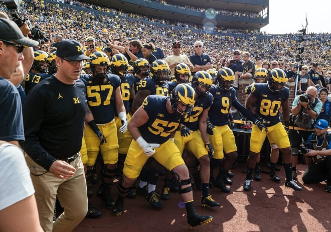 Michigan Wolverines football coach Jim Harbaugh and his team are still practicing in preparation for a season.