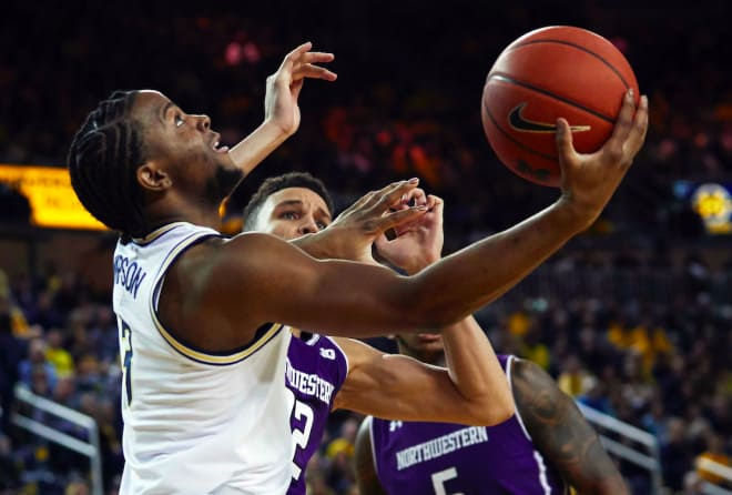 Zavier Simpson led Michigan with 24 points and Michigan improved to 17-0, a school record for wins to start a season, in a  win over Northwestern.