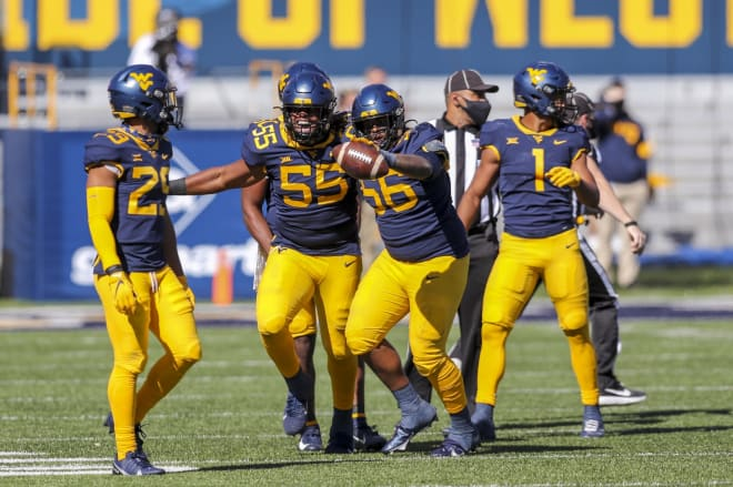 The West Virginia Mountaineers football team overcame a slow start to dispatch Kansas 38-17.