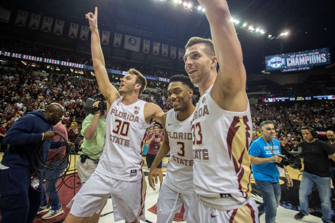 Walk-ons Harrison Prieto (left) and Will Miles (right) celebrate last year's ACC title-clinching victory against Boston College with former teammate Trent Forrest.