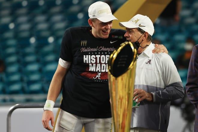 Alabama Crimson Tide quarterback Mac Jones celebrates with head coach Nick Saban following Monday night's national championship win over Ohio State. Photo | Getty Images