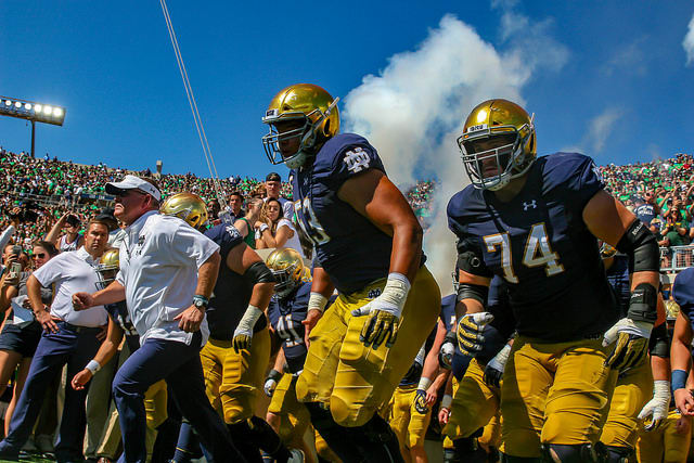 Notre Dame football runs out of the tunnel.