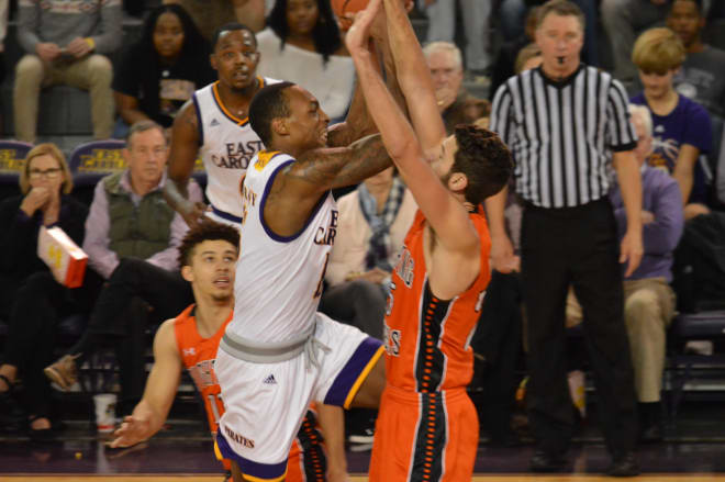 Kentrell Barkley drives in for two of his 14 points on Campbell's Andrew Eudy in ECU's 69-66 win Monday night.