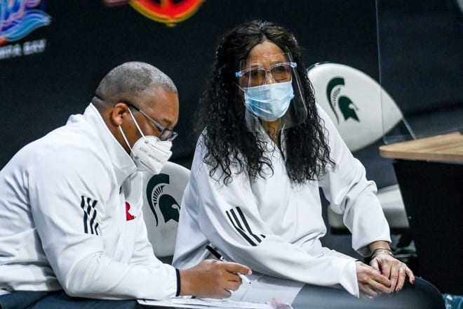 Rutgers' head coach C. Vivian Stringer, right, talks with associate head coach Tim Eatman during the second quarter on Wednesday, Feb. 24, 2021, at the Breslin Center in East Lansing.