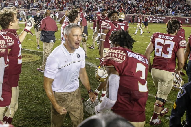 FSU coach Mike Norvell celebrates with defensive back Jarvins Brownlee after Saturday's win.