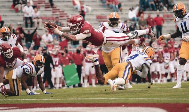 Arkansas quarterback Feleipe Franks dives for a score versus LSU.