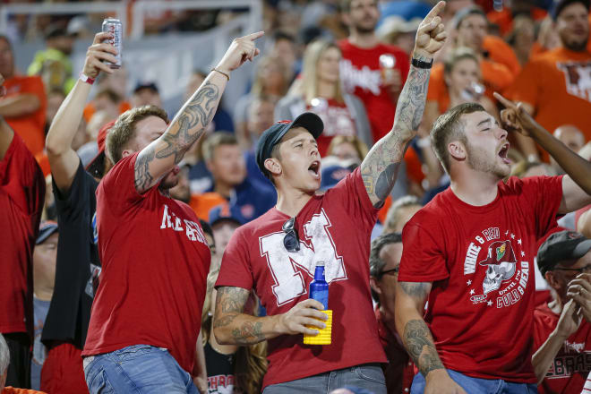 A group of younger Nebraska fans celebrate at Illinois. Champaign is one of several Power Five venues that sells beer in the stadium.