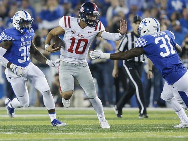 Ole Miss quarterback Jordan Ta'amu looks for extra yardage in a win at Kentucky last November.
