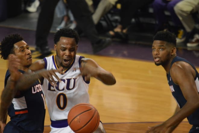 Isaac Fleming and UConn's Christian Vital battle for a loose ball in the first half of ECU's 82-73 senior day home loss.