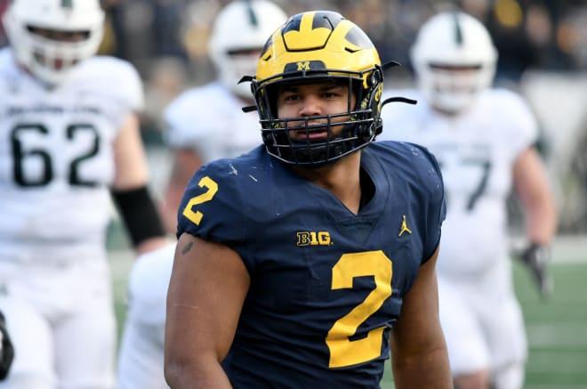 Michigan Wolverines football fifth-year senior defensive tackle Carlo Kemp had a sack against Wisconsin.