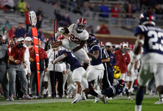 Najee Harris hurdles a defender during last month's game against Ole Miss. Photo | Getty Images