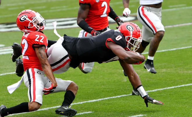 Darnell Washington is a load for any one defensive back to bring down. Just ask Javon Bullard (22).