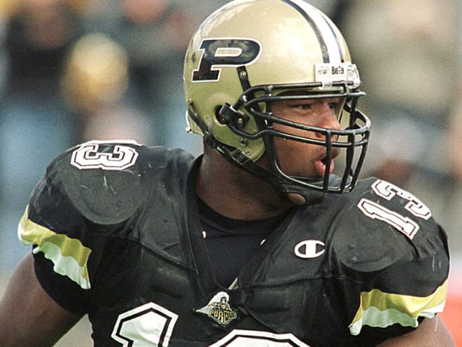 """Akin Ayodele is a member of Purdue's """"Den of Defensive Ends' as was a first=team All-Big Ten performer as a senior in 2001."""