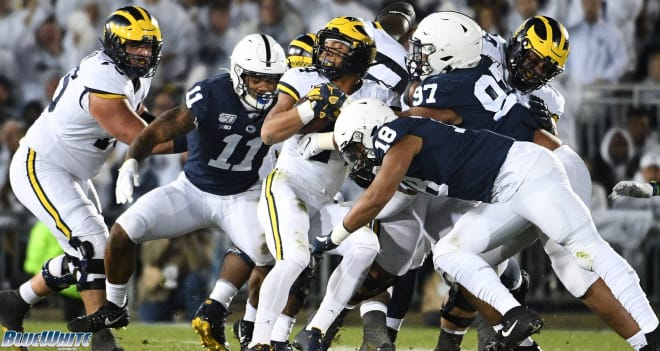 Penn State's defense makes a tackle against Michigan.