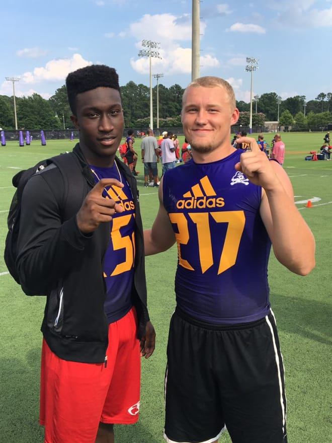 Andre Pegues pictured with East Carolina QB commit Holton Ahlers at the Pirates prospect camp.