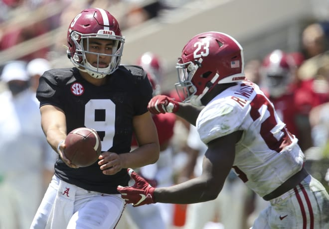 Bryce Young (9) hands off to White running back Roydell Williams (23) during the University of Alabama A-Day Game at Bryant-Denny Stadium. Photo | USA Today