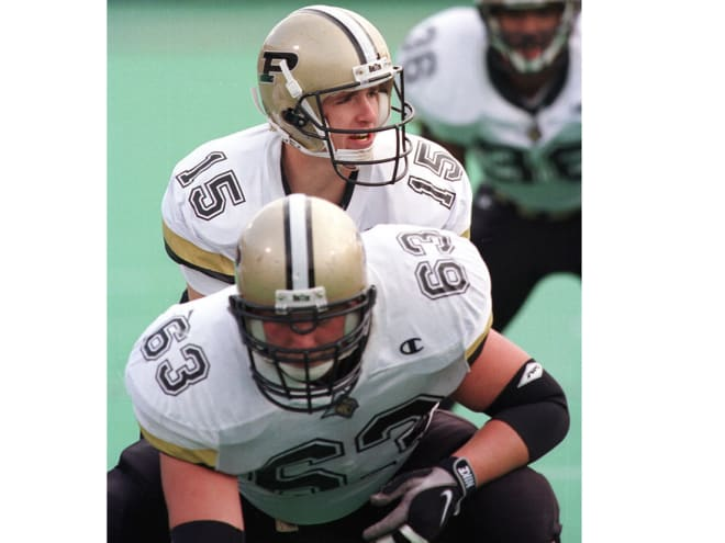 Jim Niedrach was the starting center for the Boilermakers from 1997-99, including working for two seasons with Drew Brees (pictured).