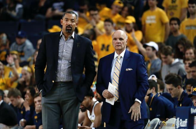 Michigan Wolverines head basketball coach Juwan Howard and assistant Phil Martelli.