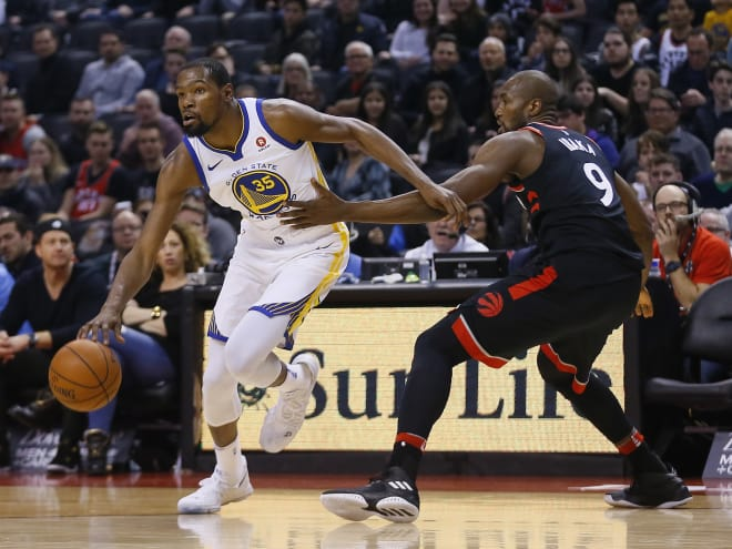 Golden State's Kevin Durant drives past Toronto's Serge Ibaka during the Warriors' win over the Raptors Saturday.