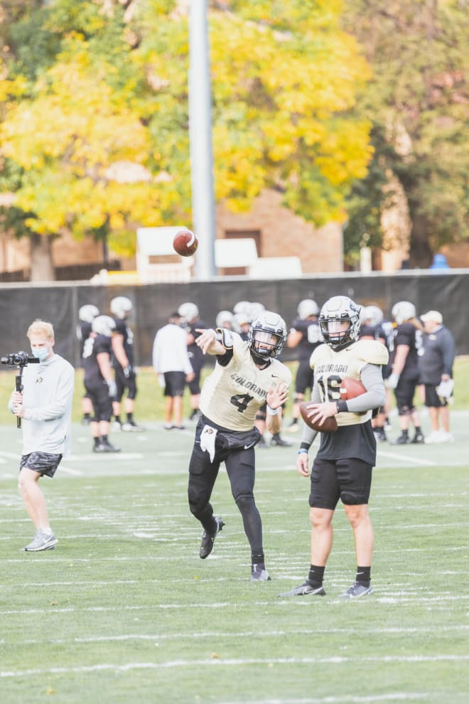 CU's lone senior signal caller, Sam Noyer, makes a throw during practice