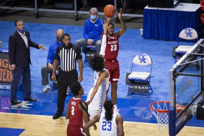 Alabama Crimson Tide guard John Petty Jr. (23) shoots a three-pointer against Kentucky Wildcats guard Brandon Boston Jr. (3) during the first half at Rupp Arena at Central Bank Center. Photo | Imagn