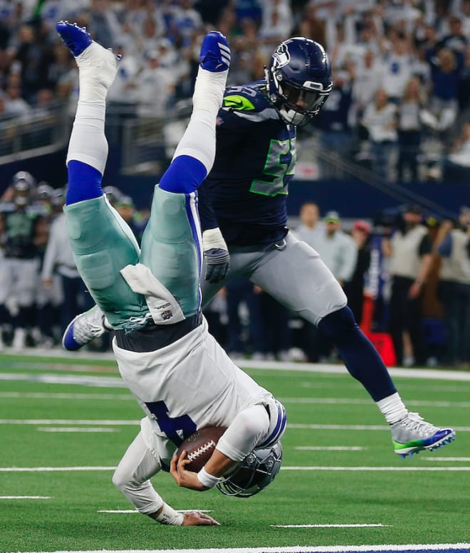 Frank Clark logged four tackles and a sack against the Cowboys, but Seattle's season came to an end with a 24-22 loss.