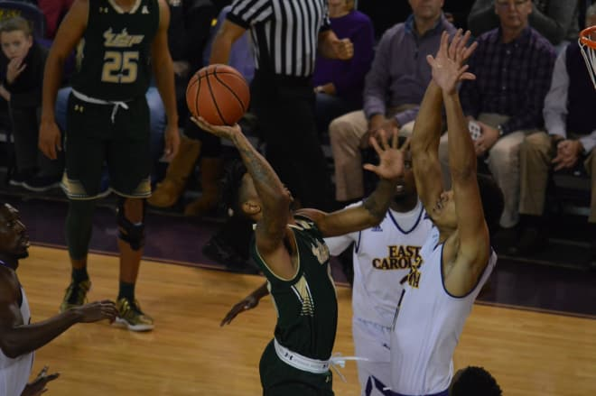 USF's Isaiah Manderson tries to shoot over 7-1 ECU center Andre Washington Wednesday night.