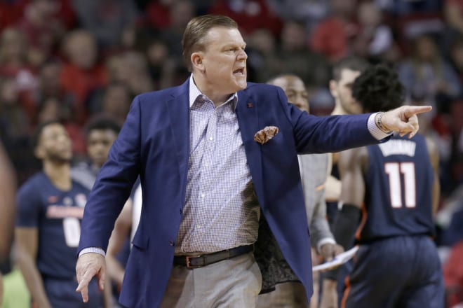 Illinois coach Brad Underwood instructs players during the second half of an NCAA college basketball game against Nebraska in Lincoln, Neb.