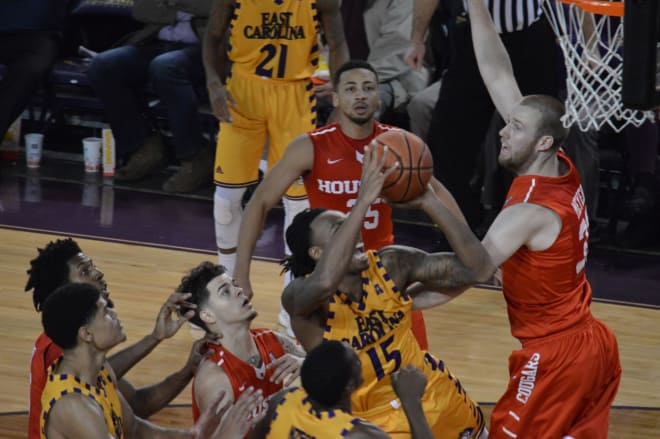 East Carolina's Kentrell Barkley drives on a host of Cougars in Houston's 74-58 win over the Pirates.