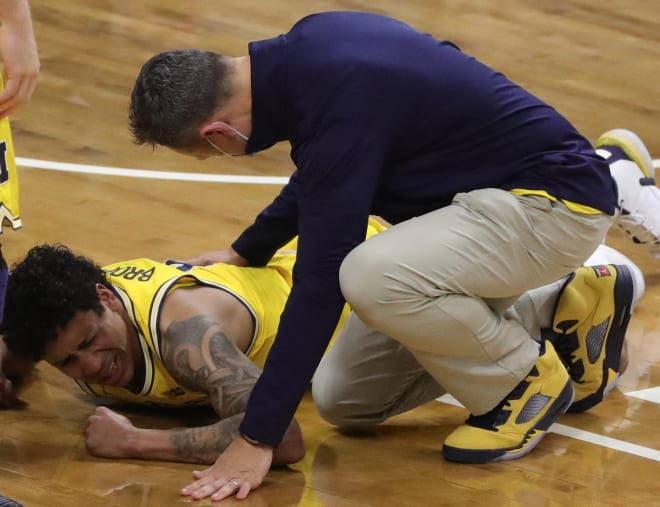 Michigan Wolverines Senior guard Eli Brooks went down early with an ankle injury at Michigan State. His prognosis is unknown.