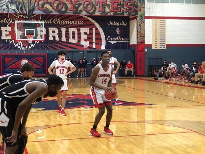 Centennial junior Jayson Petty (14) shoots in a recent game.