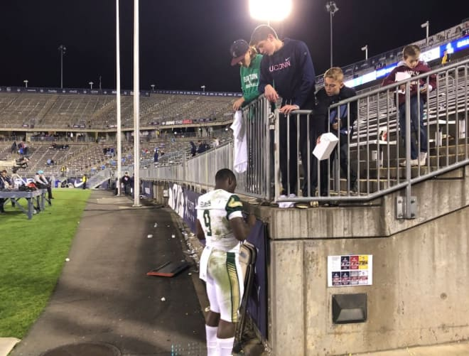 USF quarterback, Quinton Flowers signs autographs for UConn fans after putting up 519 yards offense in USF's 37-20 victory over the Huskies.