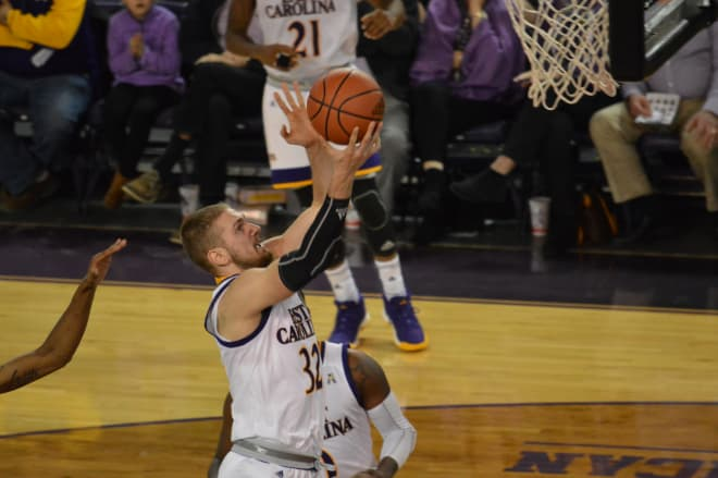 ECU's Dimitri Spasojevic drives for two of his 13 points in the Pirates' 79-68 loss to Central Connecticut.