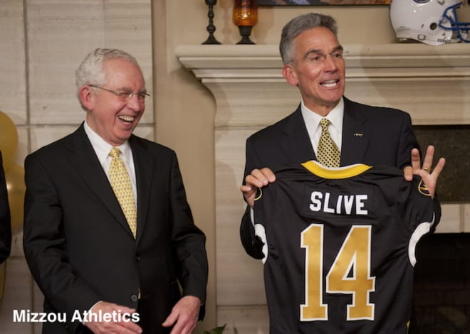 Mike Alden presented SEC Commissioner Mike Slive a Mizzou jersey when the Tigers became the league's 14th member