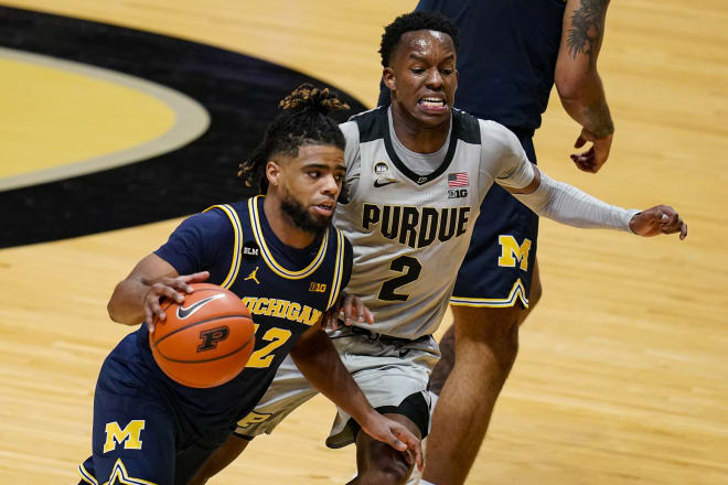 Michigan Wolverines basketball fifth-year senior guard Mike Smith is leading the Big Ten in assists per game.