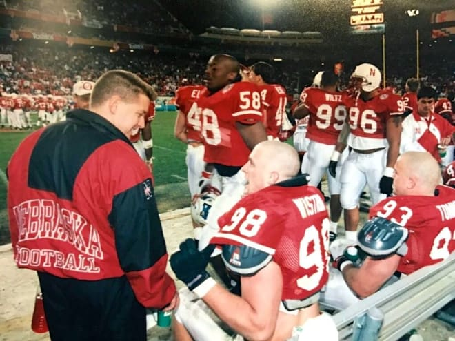 Ellis talks with Nebraska defensive linemen Grant Wistrom and Jared Tomich during the 1996 Fiesta Bowl against Florida.