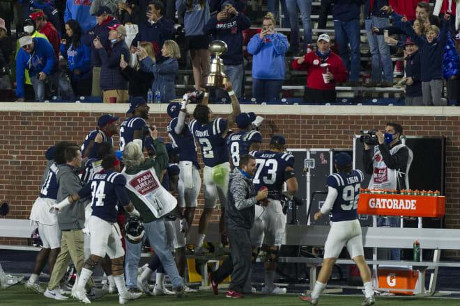 Ole Miss quarterback Matt Corral (2) and his teammates celebrate Saturday's Egg Bowl win over Mississippi State.